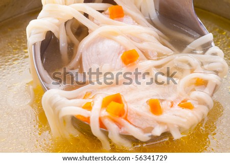Chicken soup with noodles. - stock photo
