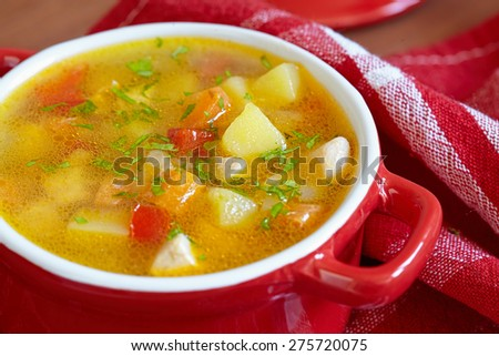 Chicken soup with potato, carrot, pepper and celery - stock photo