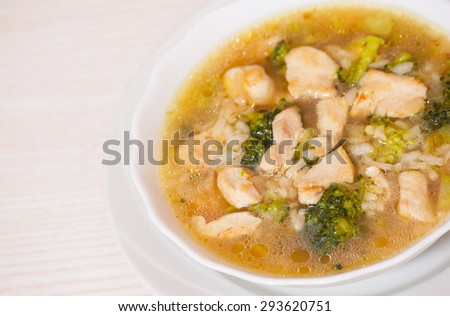 chicken soup with rice and broccoli - stock photo