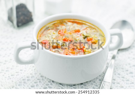 chicken soup with rice and peppers on a white background. tinting. selective focus - stock photo