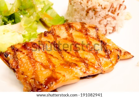 Chicken steak in a dish Serve with rice - stock photo