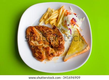 chicken steak on green background - stock photo