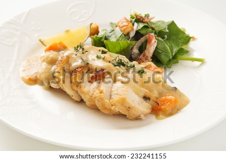 Chicken steak topped with white sauce