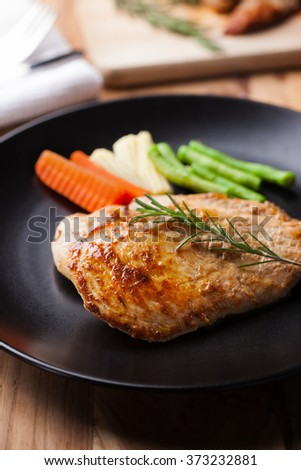 chicken steak with rosemary and vegetable  - stock photo