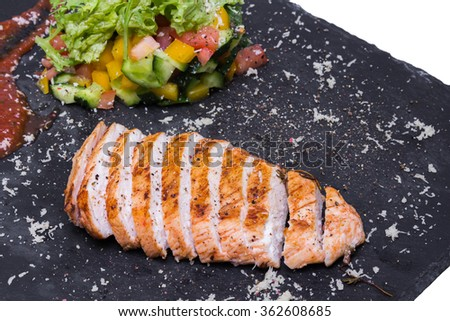 Chicken steak with sauce and vegetables - stock photo