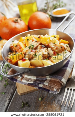 Chicken stew with pumpkin, potatoes and spices on the table