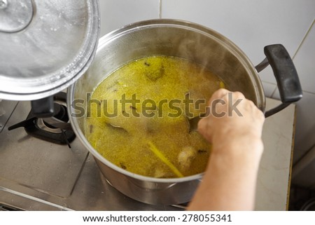 Chicken stock soup with strong herbs and spices for Soto, the traditional Indonesian chicken soup