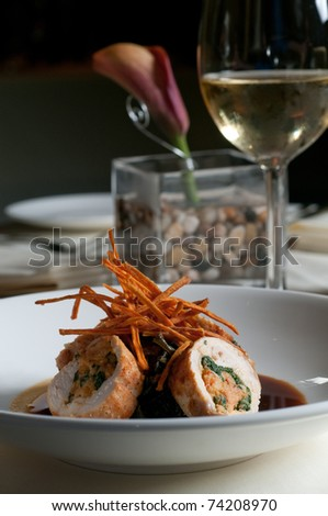 Chicken stuffed with crayfish in a dark sauce - stock photo