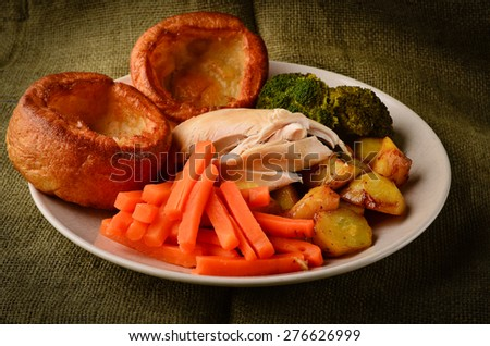 Chicken Sunday dinner with Yorkshire puddings - stock photo