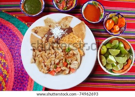 Chicken tacos Mexican style chili sauce and nachos Mexico food - stock photo
