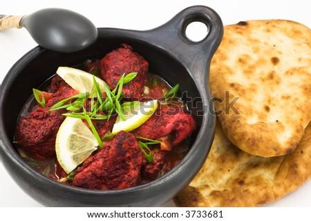 Chicken tandoori and naan bread - stock photo