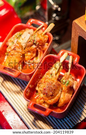 Chicken teriyaki (grilled in japanese style) with thai cilli sauce - stock photo