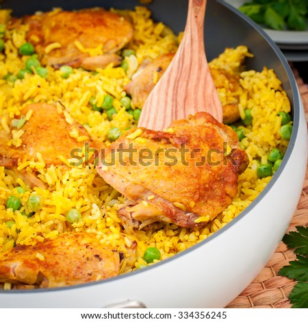 Chicken Thigh and Rice Biryani with Green Peas, square, close up - stock photo