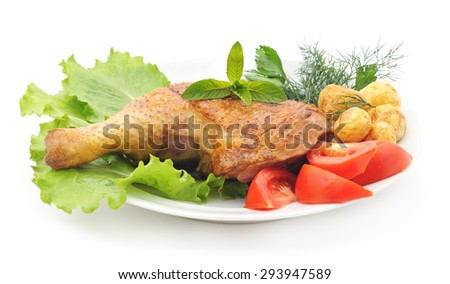 Chicken thigh with vegetables on a platter.
