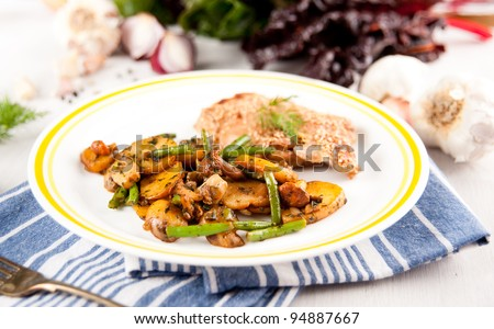 Chicken Thighs Baked and Served with Sauteed Potatoes, Mushrooms, Green Beans for Healthy Meal - stock photo