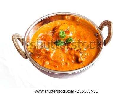 Chicken tikka masala served in a kadai isolated on white - stock photo