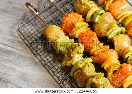 Chicken tikka on skewers ready to grill, selective focus - stock photo