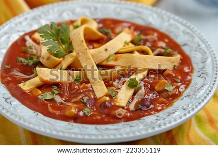 Chicken Tortilla Soup with Bean, Corn and Tomato - stock photo