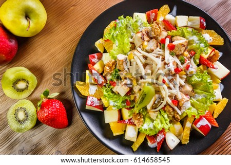 Chicken Vanilla Salad, Grilled chicken chunks with iceberg & creamy basil dressing, on fresh mix fruits, creamy vanilla dressing, and fresh walnuts
