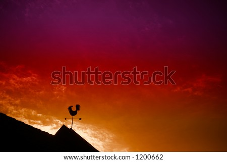 Chicken weather vane with a beautiful sky and sunset in the background - stock photo