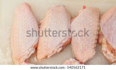 Chicken wing raw meat on white block, Photo zoom in see the detail, for shop to presentation or step How to cooking.