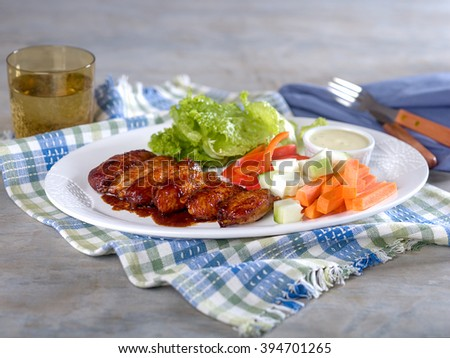 Chicken wings and vegetables with ranch dip on platter - stock photo