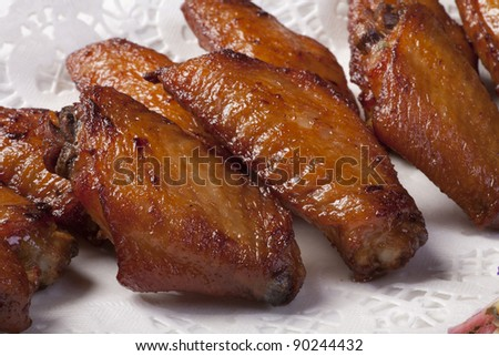 Chicken wings barbequed.
