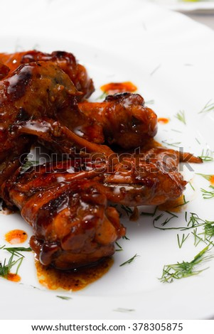 chicken wings in sauce teriyaki grilled on white plate - stock photo