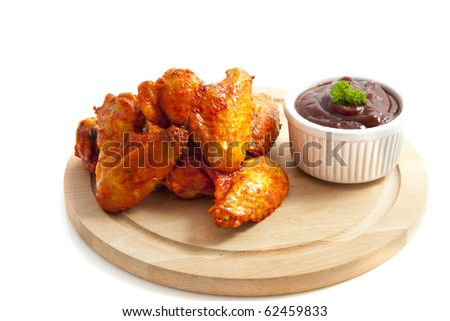 Chicken wings on wooden plate isolated over white - stock photo