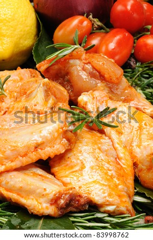 chicken wings seasoned with paprika - stock photo