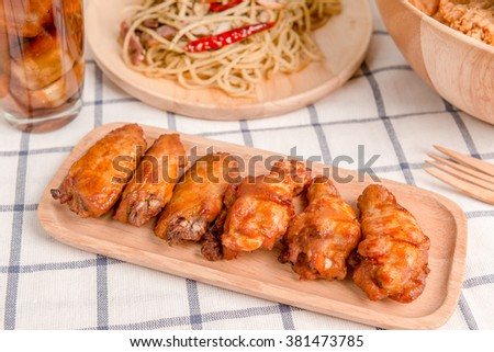Chicken wings with barbeque sauce - stock photo