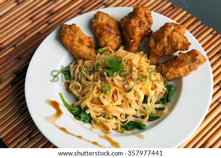 Chicken Wings with Noodles and Spinach - stock photo