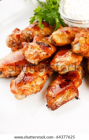 Chicken wings with sauce - stock photo
