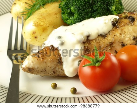 Chicken with jacket potatoes, sauce, broccoli and tomatoes - stock photo
