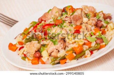 chicken with rice and vegetables - stock photo
