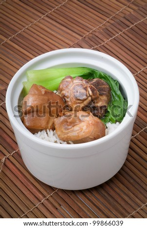 Chicken with rice and vegetables in background - stock photo