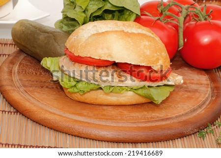 Chicken with Salad and tomato in a bun - stock photo
