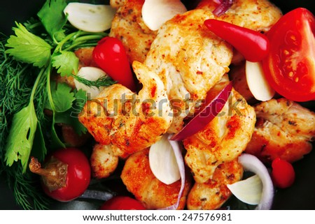chicken with tomatoes and hot peppers on pan - stock photo