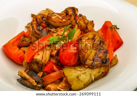 Chicken with vegetables - eggplant, tomato, pepper and herbs - stock photo