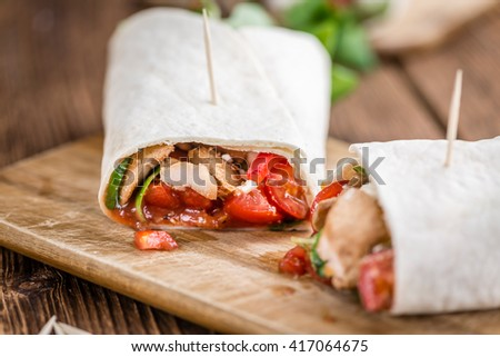 Chicken Wrap (close-up shot; selective focus) on vintage wooden background - stock photo