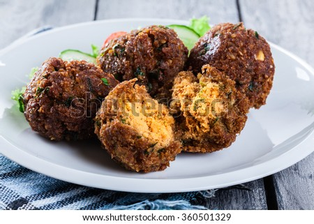 Chickpea falafel balls on a plate with vegetables - stock photo