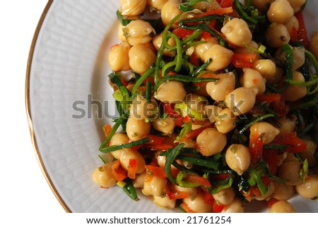 chickpea salad on a plate isolated on white