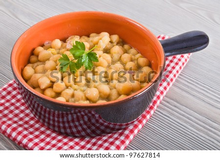 Chickpea soup in terracotta bowl.