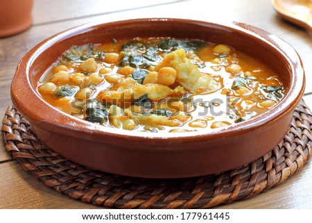Chickpea stew with spinach and cod, traditional Spanish recipe usually prepared in Holly Week and Lent. Potaje de vigilia - stock photo