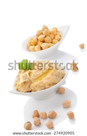 Chickpeas and hummus in bowls isolated on white background. Culinary eastern cuisine.  - stock photo