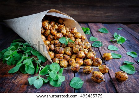 Chickpeas baked with spices on vintage, wooden background