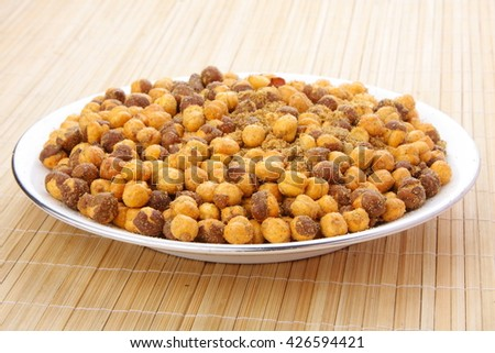Chickpeas baked with spices .Selective focus photograph. - stock photo