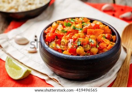 chickpeas carrots pepper coconut milk curry with brown rice. toning. selective focus - stock photo