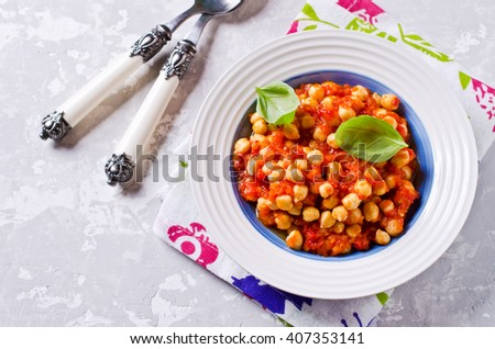 Chickpeas cooked with vegetable sauce. Selective focus.