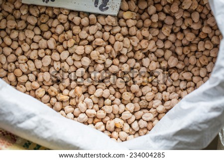 chickpeas in a bag on the market - stock photo
